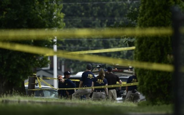 Members of the FBI inspect the crime scene after a shooting during a practice of the Republican congressional baseball at Eugene Simpson Statium Park, June 14, 2017. (AFP Photo/Brendan Smialowski)