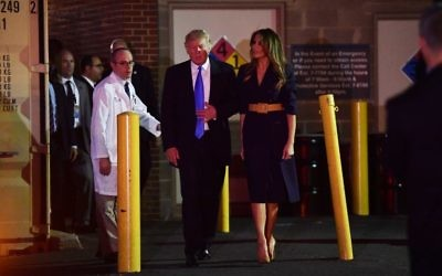 Dr. Ira Rabin (L) escorts US President Donald Trump and First Lady Melania Trump from MedStar Washington Hospital Center, June 14, 2017. (AFP Photo/Nicholas Kamm)
