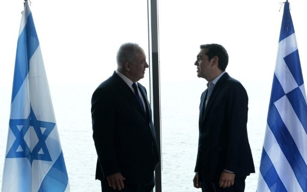 Greek Prime Minister Alexis Tsipras (R) welcomes Prime Minister Benjamin Netanyahu (L) prior to a Greece-Israel-Cyprus summit for talks on offshore oil and gas in the eastern Mediterranean and environmental issues in Thessaloniki on June 15, 2017.  (AFP PHOTO / SAKIS MITROLIDIS)
