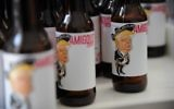 View of Amigous Craft Beer, whose bottle shows an image of US President Donald Trump wearing a mariachi costume and swastika belt buckle, in Mexico City, on June 15, 2017.  (AFP PHOTO/Bernardo Montoya)
