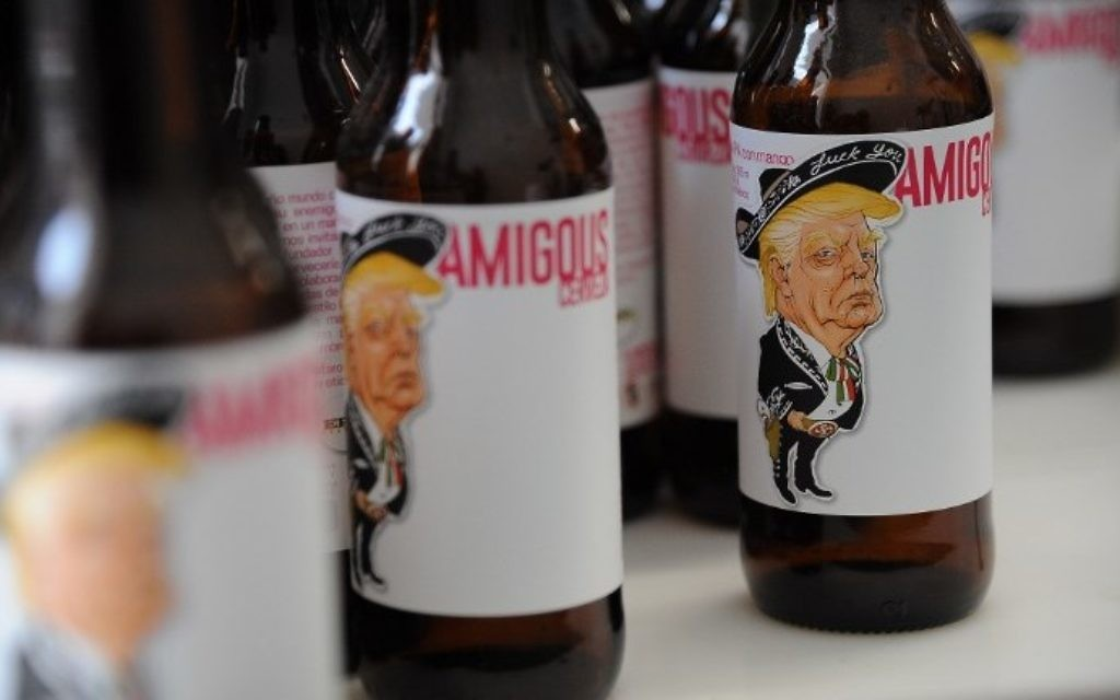 View of Amigous Craft Beer which bottle shows an image of US President Donald Trump wearing a Mariachi costume with a swastika, in Mexico City, on June 15, 2017. (AFP PHOTO / Bernardo Montoya)