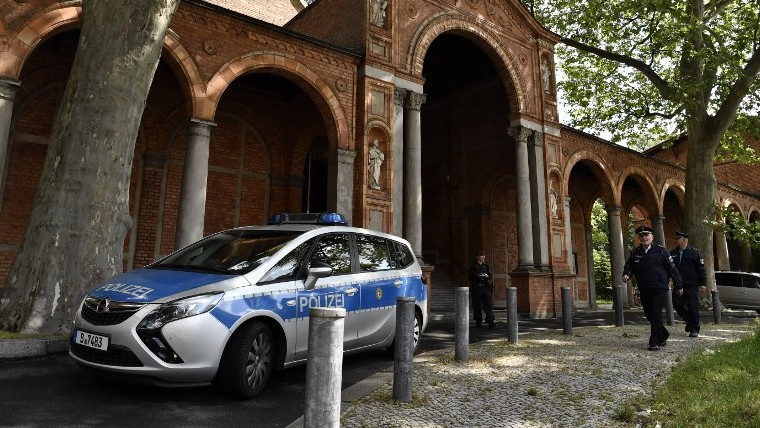 A police car is parked in front of the St. Johannis Protestant church which houses the Ibn Rushd-Goethe-mosque in Berlin on June 16, 2017. (AFP/ John MACDOUGALL)