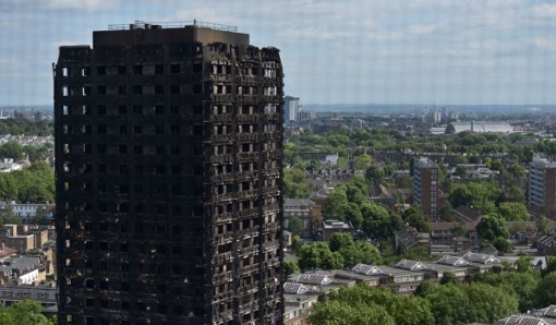 The remains of Grenfell Tower, a residential tower block in west London which was gutted by fire, pictured on June 16, 2017. (AFP Photo/Chris Ratcliffe)