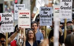 Demonstrators gather with placards outside the Department for Communities and Local Government in central London on June 16, 2017 to demand justice for those affected by the Grenfell Tower fire. (AFP/Tolga Akmen)