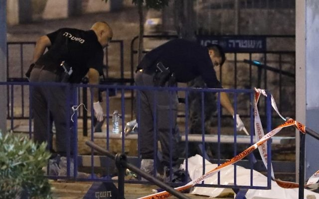 Israeli forensic police check the body of a Palestinian assailant outside Damascus Gate in Jerusalem's Old City on June 16, 2017 following a terror attack in which Israeli policewoman Hadas Malka was stabbed to death. (AFP PHOTO / Thomas COEX)