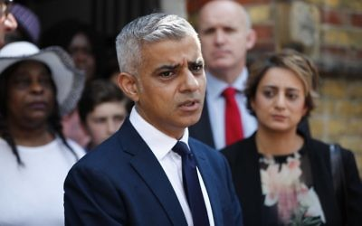 Mayor of London Sadiq Khan leaves St Clement's church in Notting Hill, west London, on June 18, 2017, close to Grenfell Tower, after attending a Sunday service. (AFP Photo/Tolga Akmen)