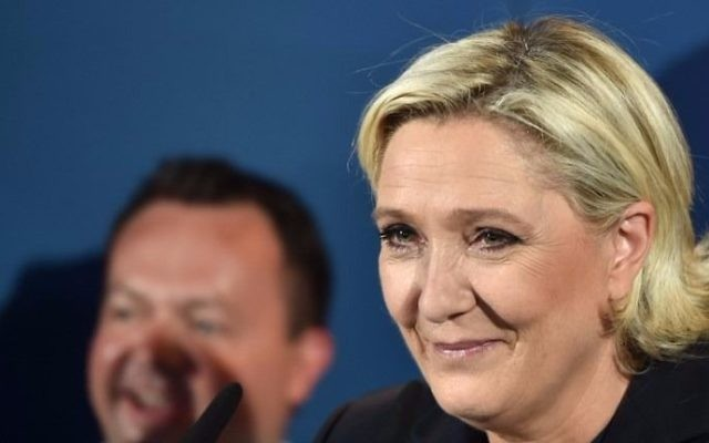 France's far-right National Front (FN) leader and parliamentary candidate Marine Le Pen speaks (C) after the polls closed during the second round of the French parliamentary elections (elections legislatives in French) on June 18, 2017 in Henin-Beaumont, northern France. (Denis Charlet/AFP)