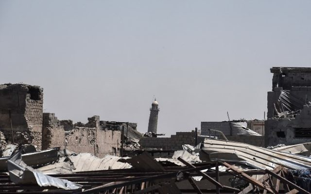 The leaning Al-Hadba minaret towering over the skyline in Mosul as the Iraqi forces advance towards the Old City on June 19, 2017 during the ongoing offensive to retake the last district still held by the Islamic State (IS) group fighters. (AFP Photo/Mohamed el-Shahed)
