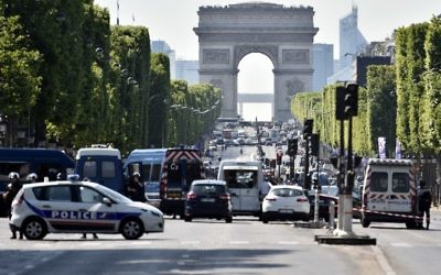 Illustrative: Police seal off the Champs-Elysees avenue after a believed terror attack targeted police, in Paris, June 19, 2017. (AFP/Alain Jocard)