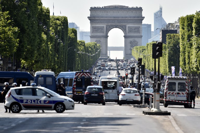 Police seal off the Champs-Elysees avenue after a believed terror attack  targeted police,