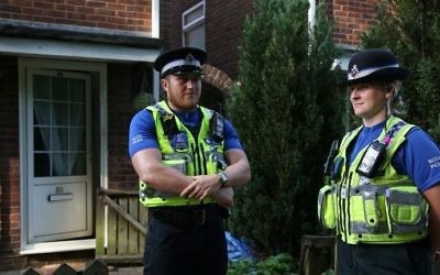 Police officers stand guard outside a residential property in Cardiff, south Wales as investigations continue into a van attack in Finsbury Park, north London on June 19, 2017. (AFP PHOTO / Geoff CADDICK)
