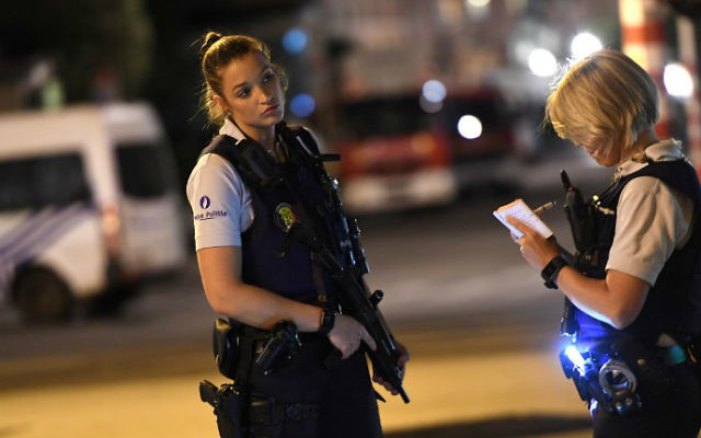 Police officers on a street outside Gare Centrale in Brussels on June 20, 2017, after an explosion. (Emmanuel Dunand/AFP)