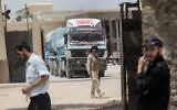 Egyptian trucks carrying fuel enter the southern Gaza Strip from Egypt through the Rafah border crossing on June 21, 2017. (AFP / SAID KHATIB)