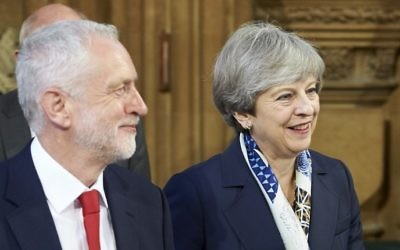 Britain's Prime Minister Theresa May (R) and Britain's main opposition Labour Party leader Jeremy Corbyn (L) walk across the Central Lobby of the Palace of Westminster after listening to the Queen's Speech during the State Opening of Parliament ceremony in London on June 21, 2017 (AFP/Pool/Niklas Halle'n)
