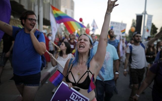 Israelis take part in the first annual Gay Pride parade in the southern Israeli city of Beersheba, on June 22, 2017.(AFP PHOTO / MENAHEM KAHANA)