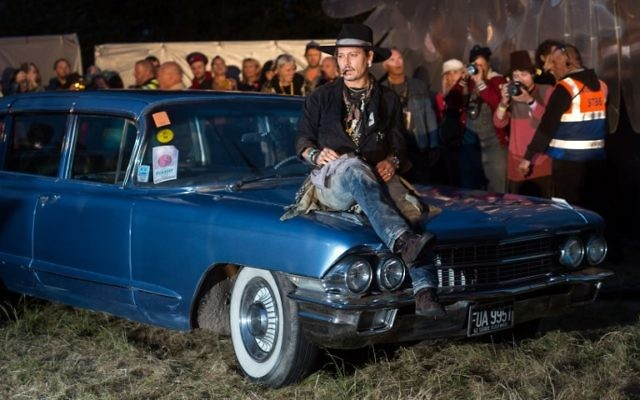 Actor Johnny Depp arrives to introduce his film, The Libertine, to the audience at 'Cineramageddon', the outdoor cinema venue, at the Glastonbury Festival of Music and Performing Arts on Worthy Farm near the village of Pilton in Somerset, South West England, on June 22, 2017. (AFP PHOTO / OLI SCARFF)