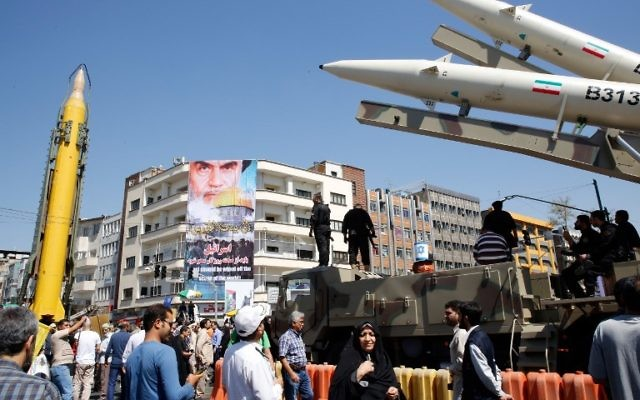 A Shahab-3 long range missile, left, and Zolfaghar missiles, right, are displayed during a rally marking al-Quds (Jerusalem) Day in Tehran on June 23, 2017.  (AFP Photo/Stringer)