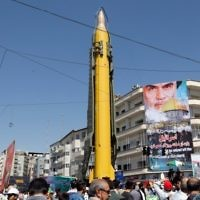 A Shahab-3 long range missile is displayed during a rally marking Jerusalem Day in Tehran, on June 23, 2017.  (AFP PHOTO / Stringer)