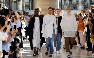 Models present creations by Israeli designer Hed Mayner during the Men's Fashion Week for the Spring and Summer 2018 collection in Paris, on June 23, 2017 (AFP PHOTO / FRANCOIS GUILLOT)