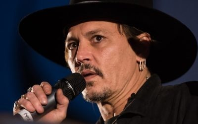 This file photo taken on June 22, 2017 shows actor Johnny Depp introducing his film 'The Libertine' to the audience at Cineramageddon, the outdoor cinema venue, at the Glastonbury Festival of Music and Performing Arts in Pilton in Somerset, South West England. (AFP/Oli Scarff)