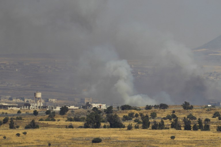 A picture taken from the Israeli Golan Heights shows smoke billowing from the Syrian side of the border on June 24, 2017. (AFP PHOTO / JALAA MAREY)