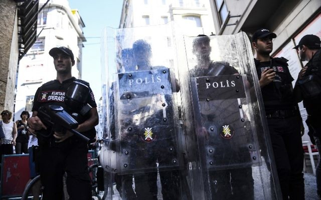 Turkish riot police officers block an access to Istiklal Avenue to prevent LGBT rights activists from going ahead with a Gay Pride annual parade on June 25, 2017, in Istanbul, a day after it was banned by the city governor's office. (AFP PHOTO / BULENT KILIC)