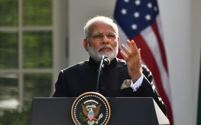 Indian Prime Minister Narendra Modi speaks during a joint press conference with US President Donald Trump (not seen) in the Rose Garden at the White House on June 26, 2017. (AFP Photo/Nicholas Kamm)