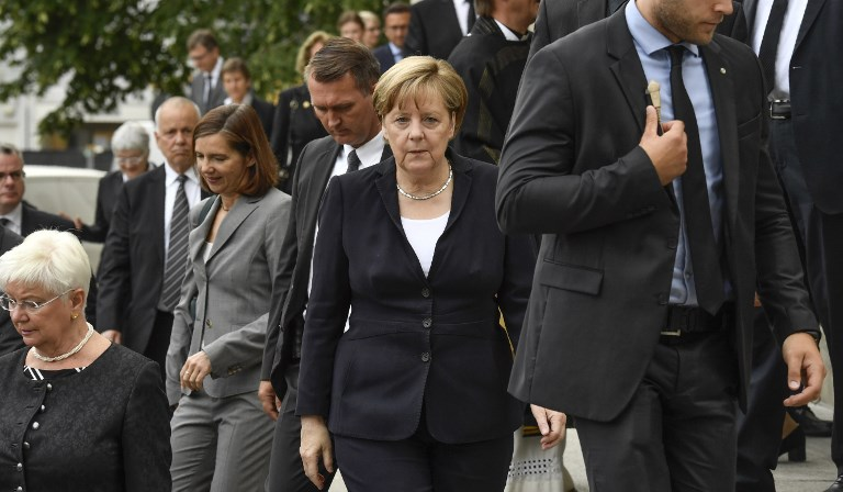 German Chancellor Angela Merkel (C) leaves the Saint Hedwig Cathedral after attending a memorial service for late former chancellor Helmut Kohl on June 27, 2017 at the Hedwig Cathedral in Berlin. (AFP PHOTO / John MACDOUGALL)