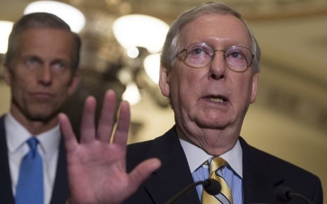 US Senate Majority Leader Mitch McConnell (R), Republican of Kentucky, speaks about the Senate Republican's healthcare bill alongside US Senator John Thune (L), Republican of South Dakota, at the US Capitol in Washington, DC, June 27, 2017. (AFP/ SAUL LOEB)