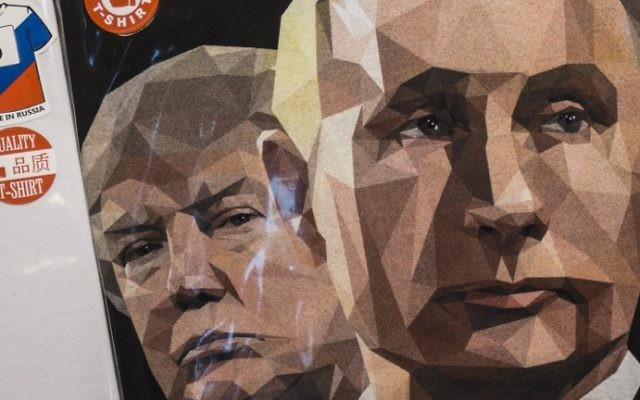 """A picture taken on June 27, 2017 shows a T-shirt featuring the US President Donald Trump and Russian President Vladimir Putin with a sign """"We Love Russia"""" on sale at a souvenir shop in Saint Petersburg.  (Mladen ANTONOV / AFP)"""