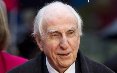 "This photo taken on November 23, 2014, shows Michael Bond, the creator of Paddington Bear, posing for pictures on the red carpet upon arrival for the world premiere of ""Paddington"" in London. (JUSTIN TALLIS / AFP)"