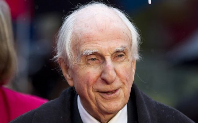 """This photo taken on November 23, 2014, shows Michael Bond, the creator of Paddington Bear, posing for pictures on the red carpet upon arrival for the world premiere of """"Paddington"""" in London. (JUSTIN TALLIS / AFP)"""