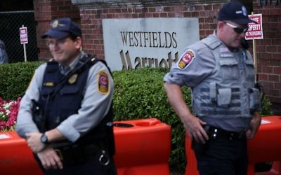 Members of Fairfax County Police stand guard at the entrance of Westfield Marriott Hotel where the Bilderberg Meeting takes place June 1, 2017 in Chantilly, Virginia. (Alex Wong/Getty Images/AFP)