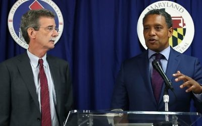 Maryland Attorney General Brian Frosh (L) and District of Columbia Attorney General Karl Racine speak to the media about filing a lawsuit against US President Donald Trump, on June 12, 2017 in Washington, DC. (Mark Wilson/Getty Images/AFP)