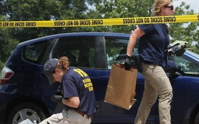 Members of the FBI Evidence Response Team collect evidence at the site of a shooting at Eugene Simpson Stadium Park June 14, 2017 in Alexandria, Virginia. (ALEX WONG / GETTY IMAGES NORTH AMERICA / AFP)