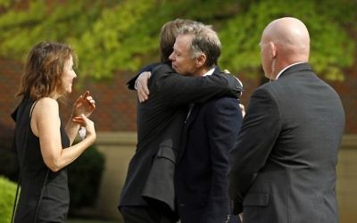 Fred and Cindy Warmbier greet guest during the funeral for their son Otto Warmbier at Wyoming High School June 22, 2017 in Wyoming, Ohio.(Bill Pugliano/Getty Images/AFP)