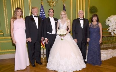 (L-R) First Lady Melania Trump, President Donald Trump, Secretary of the Treasury Steven Mnuchin, Louise Linton, Vice President Mike Pence, and Second Lady Karen Pence pose at the wedding of Mnuchin and Linton on June 24, 2017 at Andrew Mellon Auditorium in Washington, DC. (Kevin Mazur/Getty Images for LS/AFP)