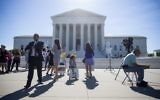 Illustrative: Outside the US Supreme Court, after it was announced that the court will allow a limited version of US President Donald Trump's travel ban to take effect, June 26, 2017, in Washington, DC. (Eric Thayer/Getty Images/ AFP)
