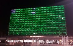 Tel Aviv City Hall lit in green to protest the US decision to withdraw from the Paris climate change accord. (Ron Huldai via Facebook)