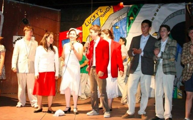 A teenage Ben Platt (center, red jacket) performs in 'Guys and Dolls' at Camp Ramah in California. (Courtesy Camp Ramah)