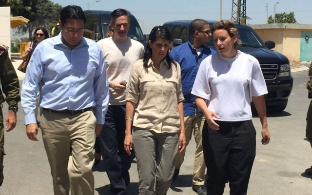 US Ambassador to the UN Nikki Haley, accompanied by Israeli Ambassador to the UN Danny Danon, left, visits with residents of Kibbutz Nahal Oz, June 8, 2017. (Courtesy)