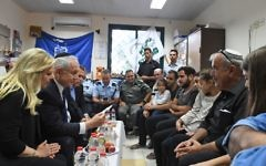 Prime Minister Benjamin Netanyahu (2l) and his wife Sara (l) pay a condolence visit to the home of slain Border Police officer Hadas Malka on June 18, 2017. (Koby Gideon/GPO)