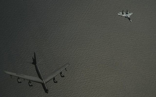 A Russian Su-27 (right) flies alongside a US B-52 bomber over the Baltic Sea on June 6, 2017 (US Air Force/ Sgt. Jonathan Snyder)