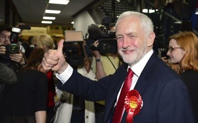 Britain's Labour Party leader Jeremy Corbyn gestures as he arrives for the declaration at his constituency in London, Friday, June 9, 2017 (Dominic Lipinski/PA via AP)