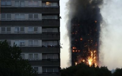 Smoke and flames rise from a building on fire in London, Wednesday, June 14, 2017. (AP/Matt Dunham)
