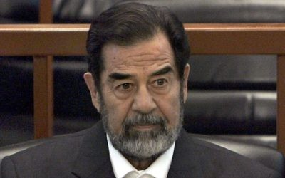 In this Dec. 6, 2006 file photo, former Iraq leader Saddam Hussein sits in court in Baghdad, Iraq, during the trial against him. (AP Photo/Chris Hondros, Pool, File)