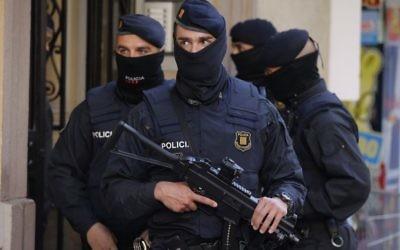 Illustrative: Spanish police officers prior to arresting an unidentified man in Barcelona, Spain on April 25, 2017. (AP Photo/Manu Fernandez)