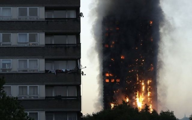 Smoke and flames rise from the Grenfell Tower apartment building in West London, June 14, 2017. (AP/Matt Dunham)