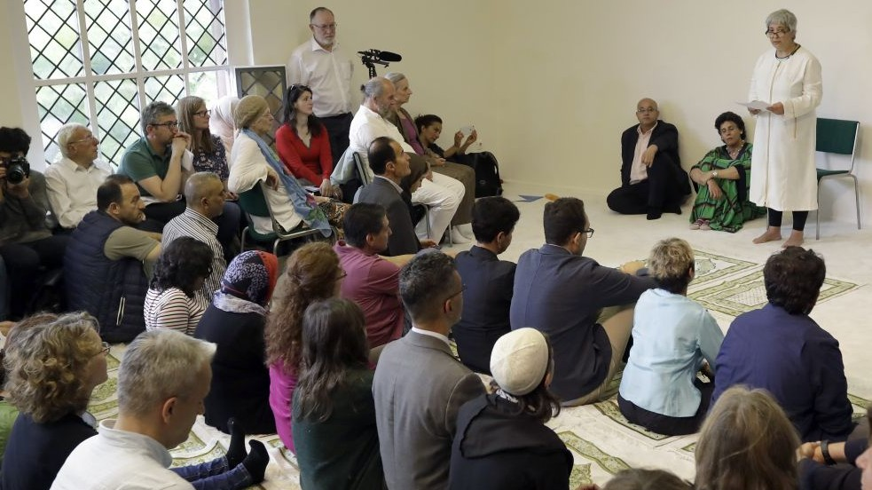 Seyran Ates, right, founder of the Ibn-Rushd-Goethe-Mosque preaches during the opening of the mosque in Berlin, Germany, Friday, June 16, 2017. Ates a daughter of Turkish immigrants has founded the first liberal mosque in Germany where men and women can pray together, homosexuals are welcome and Muslims of all sects can leave their inner-religious conflicts behind. (AP /Michael Sohn)