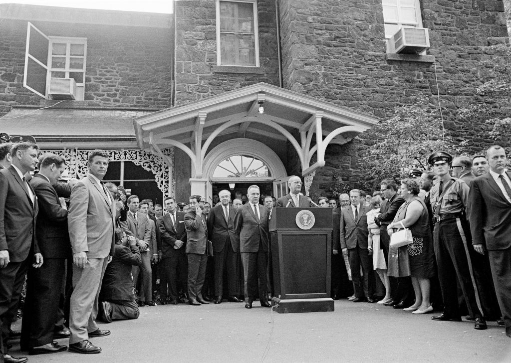 In this June 23, 1967 file photo, President Lyndon Johnson speaks at the podium as Soviet Premier Alexi Kosygin listens in front of the Hollybush mansion, on the campus of Glassboro State College, in Glassboro, N.J. They were at Hollyhbush for a hastily arranged U.S./USSR summit that brought the leaders together during the Cold War and days after the Six-Day War 50 years ago. Ambassador to Washington Anatoly Dobrynin is at the left of Kosygin. New Jersey Gov. Richard Hughes and his wife Elizabeth, with purse, at right, stand next to a NJ State Trooper. (AP Photo, File)